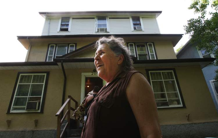 Cathy outside the Furby Street rooming house she calls home.  (JOE BRYKSA / WINNIPEG FREE PRESS)