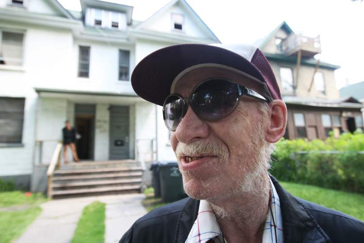 Michael outside the Spence Street rooming house he calls home.   (JOE BRYKSA / WINNIPEG FREE PRESS)