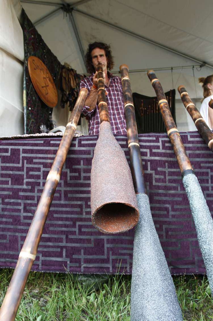 Scott Buxton demonstrates circular breathing on one of his didgeridoos.