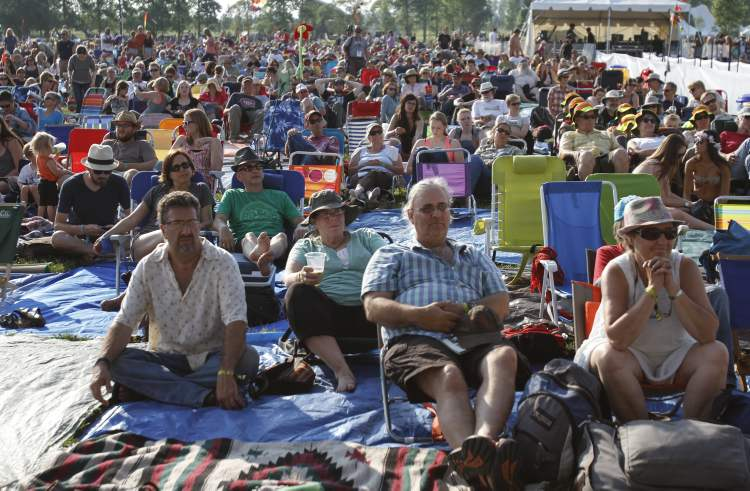 People wait patiently on near the main stage for locals Oh My Darling to open Wednesday night's performances.