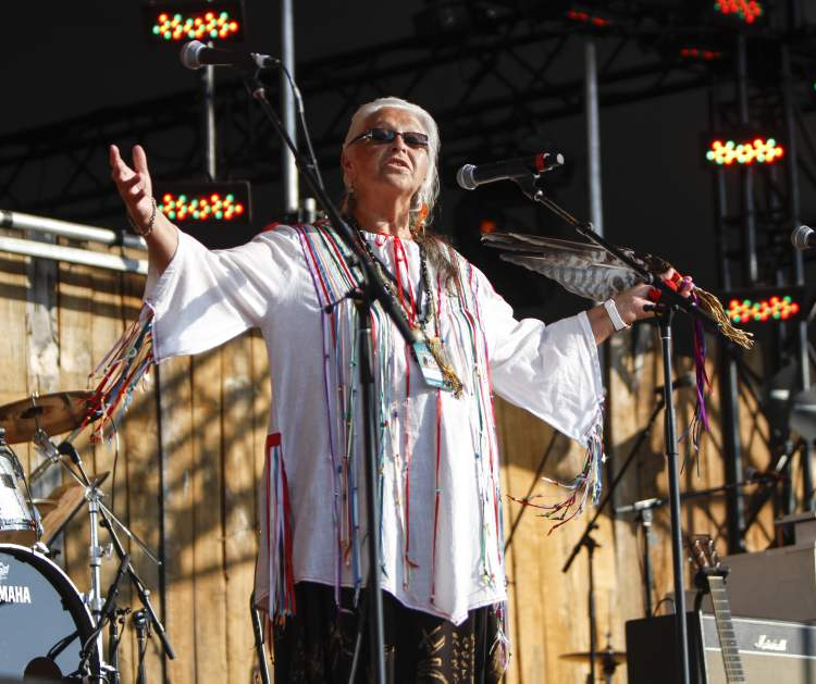 Ojibway Métis elder Mae Louise Campbell offered the Winnipeg Folk Festival's opening blessing on the Main Stage Wednesday night. (JESSICA BURTNICK / WINNIPEG FREE PRESS)