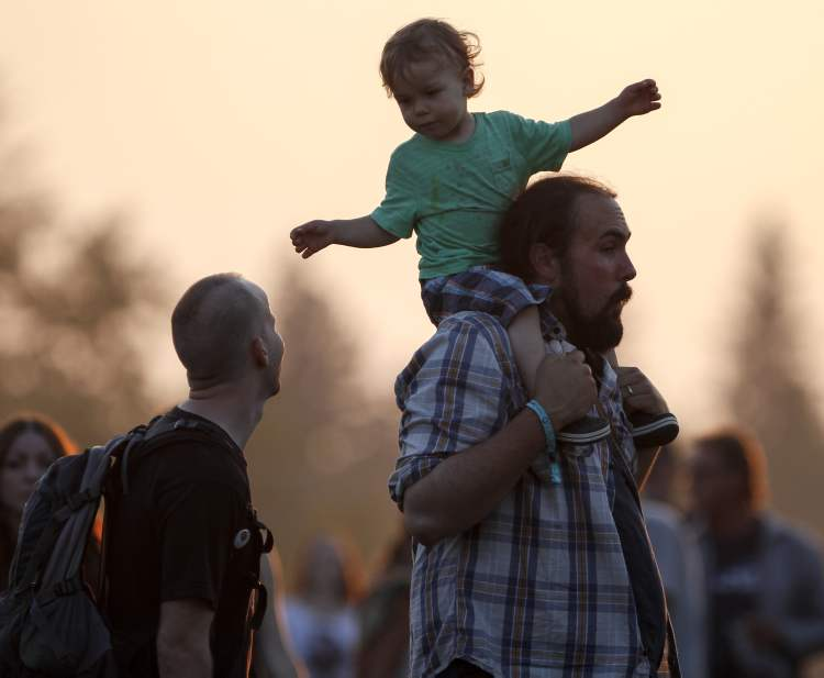 Festival-goers groove to the Avett Brothers.