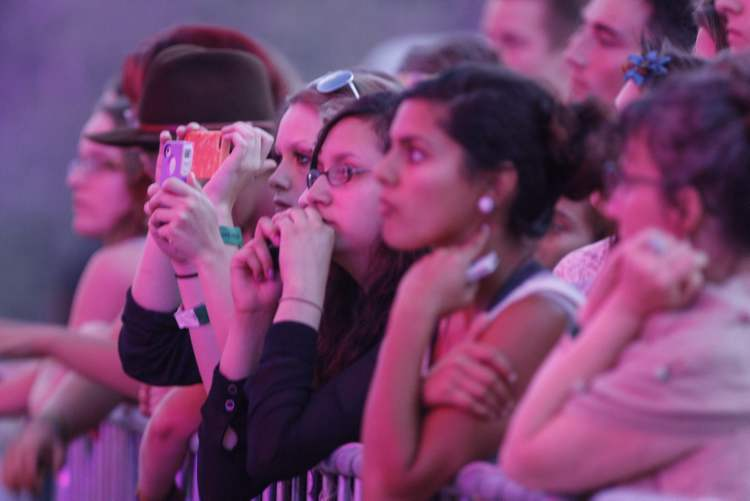 Fans watch City and Colour attentively.