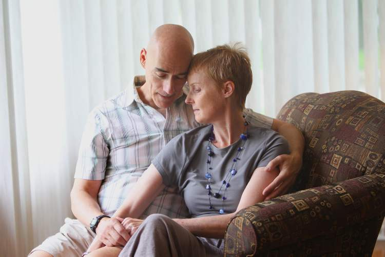 Columnist Lindor Reynolds shares a tender moment with her husband, Neil, after recently being diagnosed with brain cancer.