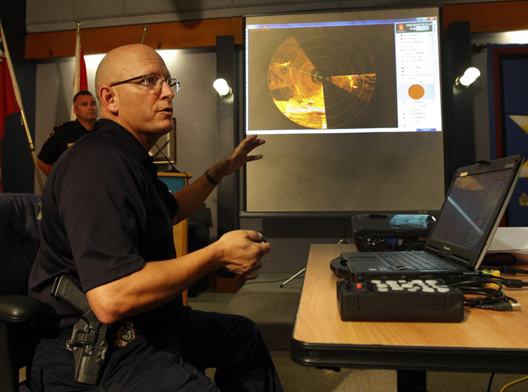 Sgt. Ron Riffel shows off sonar from an underwater scanner to be used in searches by the police dive team.