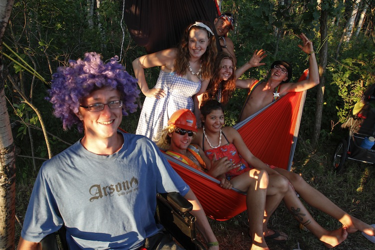(Clockwise from left) Blue Markwart, Samantha Squanch, Nik O'Regan, Heather Williams, Dylan Markwart, Hayley Esperance and Colton Bloomquist chill out in a double-decker hammock. (JESSICA BURTNICK / WINNIPEG FREE PRESS)
