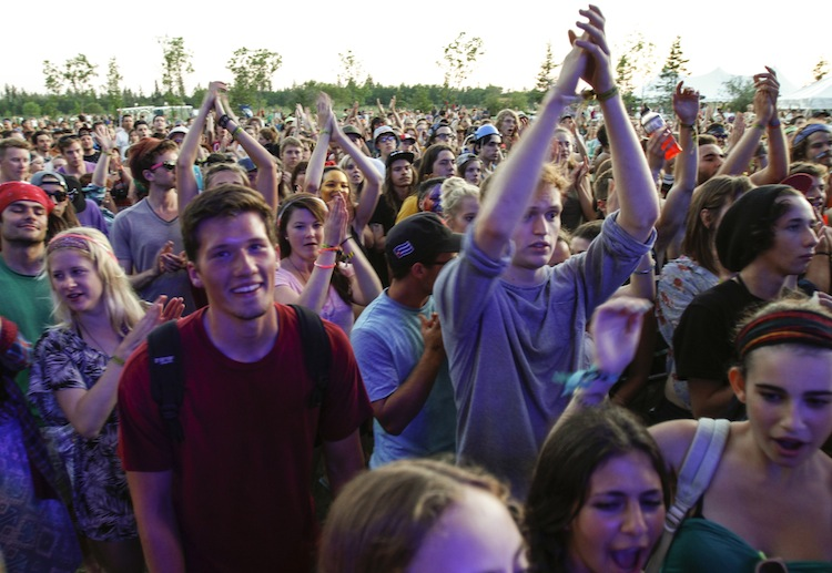 Fans cheer as Dr. Dog plays on the Big Blue stage Friday evening.
