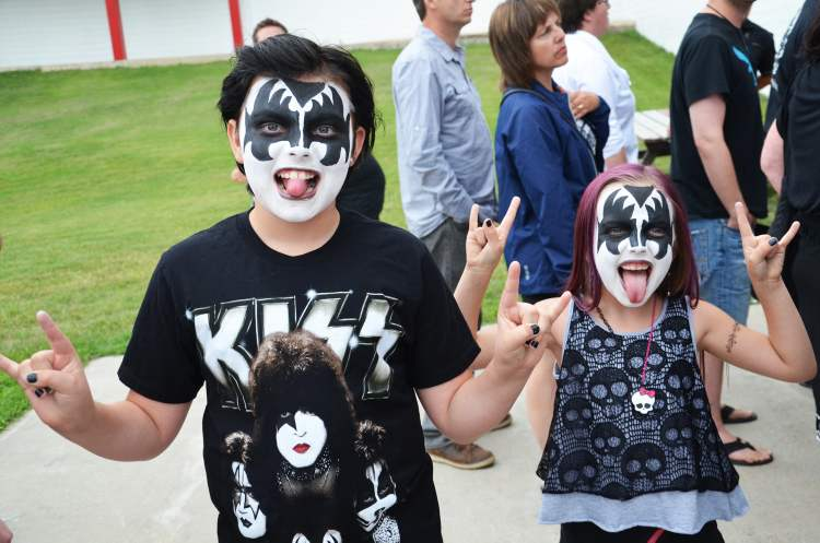 Young Kiss fans Mason and Rhiannon get ready to 'shout it out loud' before Wednesday night's concert in Brandon. (Lauren Parsons / Brandon Sun)