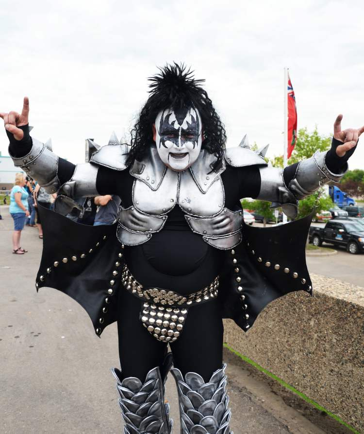 Tim Challner from Boissevain poses for photos before Wednesday night's Kiss concert in Brandon.