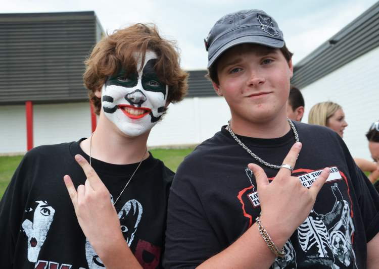 Brothers Gord and Ian Sinclair stand in line for merchandise before Wednesday night's Kiss concert in Brandon. (Lauren Parsons / Brandon Sun)