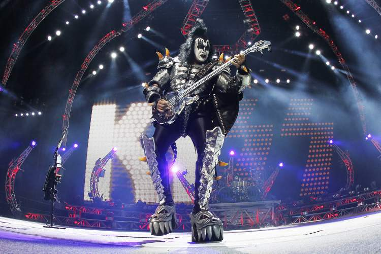 Gene Simmons focuses on his bass work.