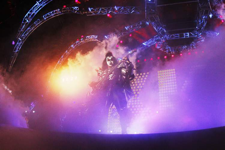 Gene Simmons emerges from the stage effects. (John Woods / Winnipeg Free Press)