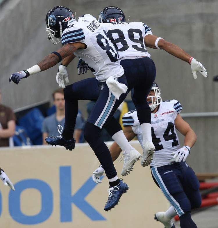 Toronto Argonauts Spencer Watt (89) celebrates his touchdown with teammate Jason Barnes during the second quarter. (JOE BRYKSA / WINNIPEG FREE PRESS)