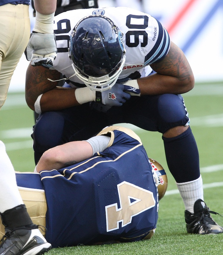 Cleyon Lang of the Toronto Argonauts taunts Winnipeg Blue Bombers quarterback Buck Pierce after Pierce was sacked late in the second quarter during Friday night's game. (JOE BRYKSA / WINNIPEG FREE PRESS)