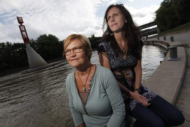 Karla Penner (right) and Joyce Kehler Hildebrand are organizing a vigil Thursday to give Winnipeggers an opportunity to grieve.