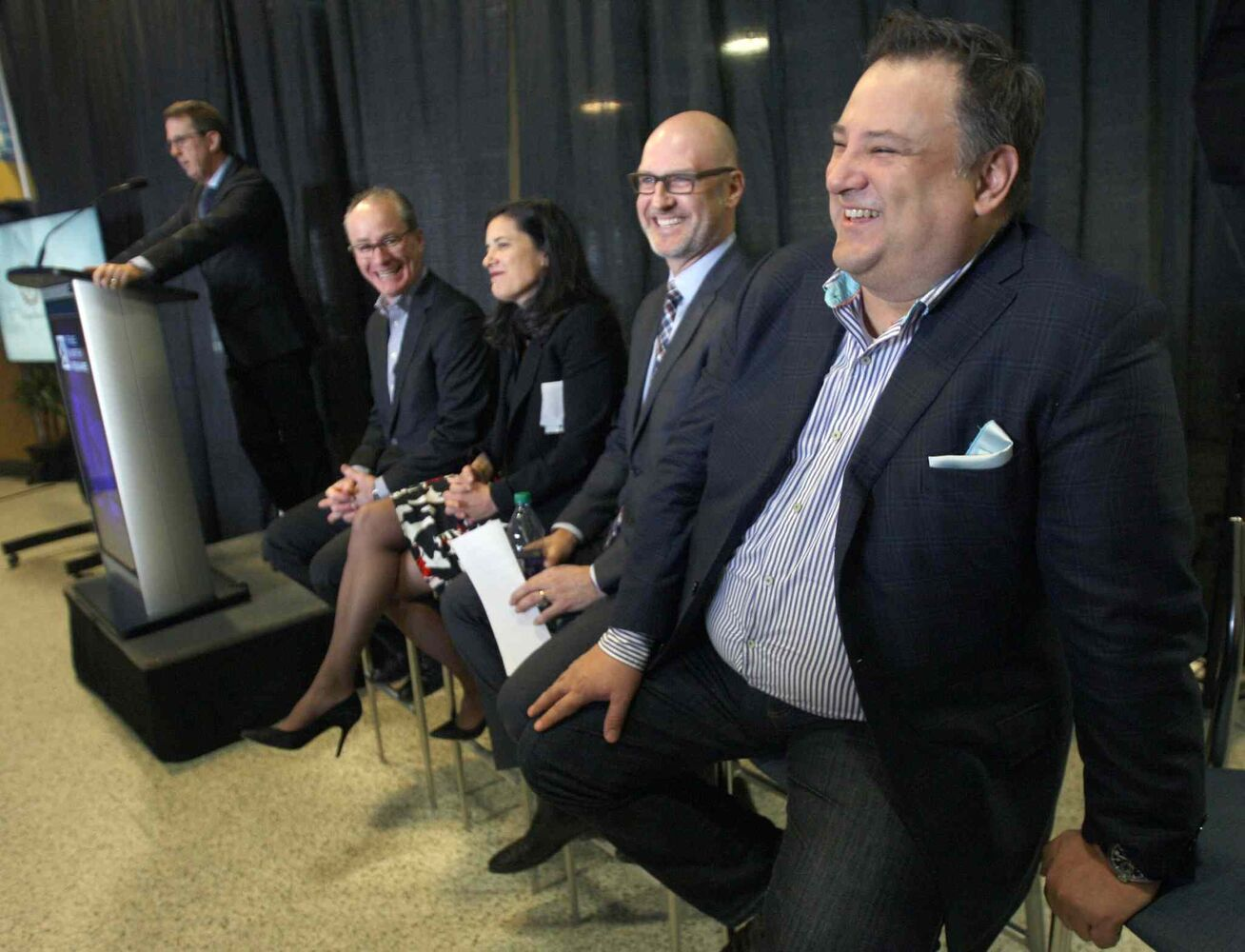 Tom Gaglardi, right, Chairman and CEO of Sutton Place Hotels laughs as Mark Chipman introduces him at the news conference. (JOE BRYKSA / WINNIPEG FREE PRESS )