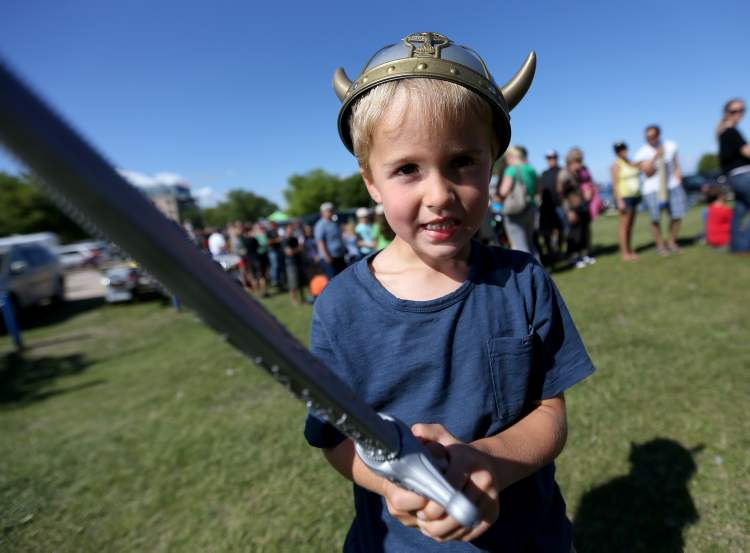 Colton Boulanger, 4, does his best Viking impersonation. (TREVOR HAGAN / WINNIPEG FREE PRESS)