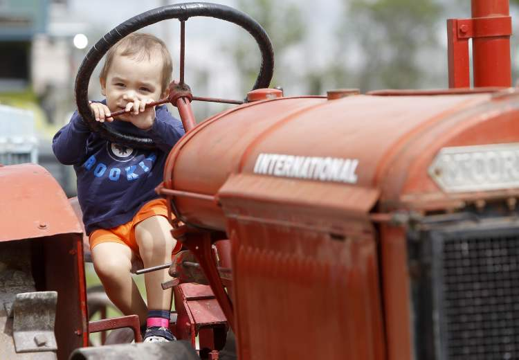 Dylan Rempel, 2, on a tractor at the Steinbach Pioneer Days.