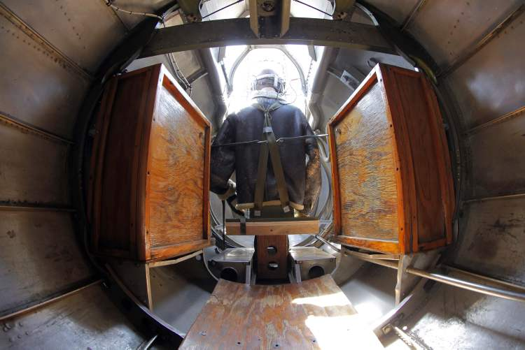 The tail gunner dummy is seen from the inside of the plane. (BORIS MINKEVICH / WINNIPEG FREE PRESS)
