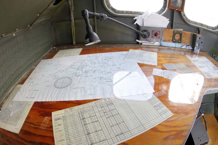 A table with documents in the nose of the B-17 bomber.