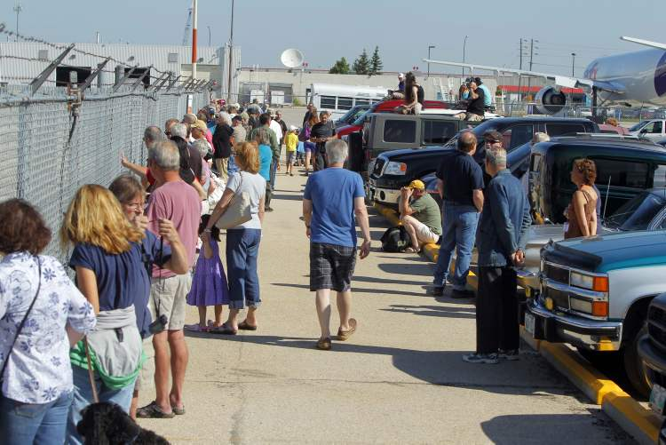 Hundreds of people flocked to the Western Canada Aviation Museum to watch Sentimental Journey land, and to get a tour of the old warbird. (BORIS MINKEVICH / WINNIPEG FREE PRESS)