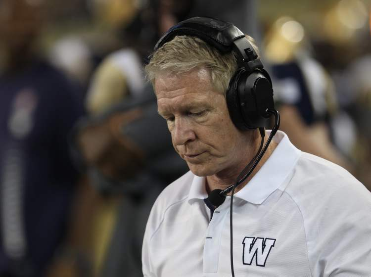 Winnipeg Blue Bombers coach Tim Burke looks down as the final minutes tick away. (JOE BRYKSA / WINNIPEG FREE PRESS)
