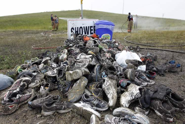 Discarded shoes piled up near the finish line. (TREVOR HAGAN / WINNIPEG FREE PRESS)