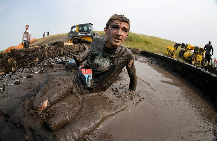 At least his face is relatively mud-free. (TREVOR HAGAN / WINNIPEG FREE PRESS)