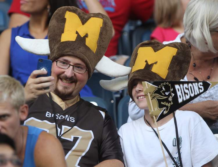Bison fans sport Flintstone-esque Bisons headgear in support of their team. (JOE BRYKSA / WINNIPEG FREE PRESS)