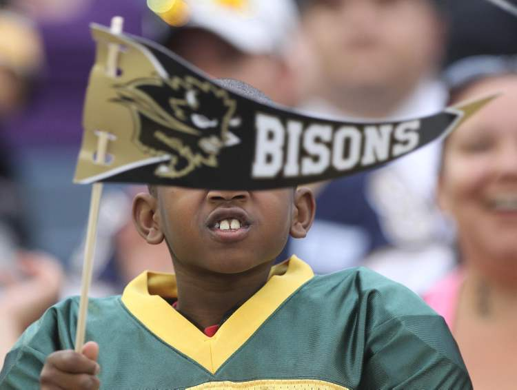 A Manitoba Bisons fan shows some home team support.