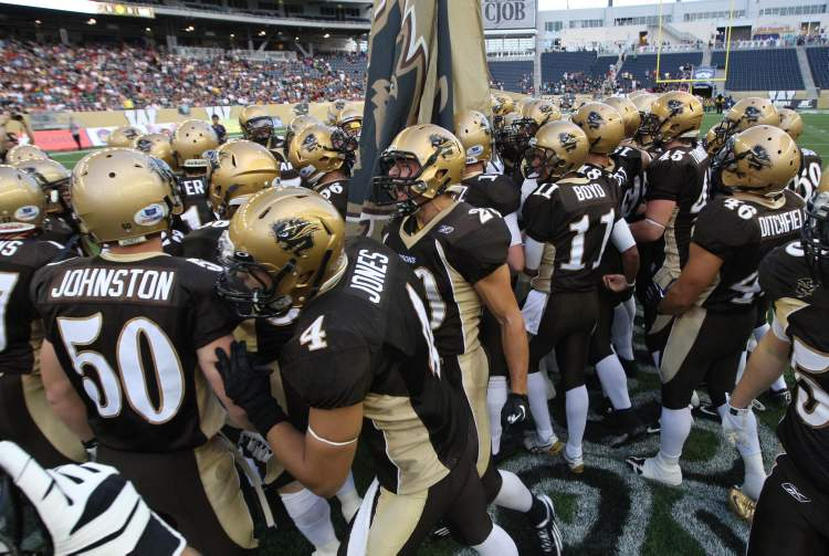 University Of Manitoba Bison Players gather at centre field at the beginning of the game.