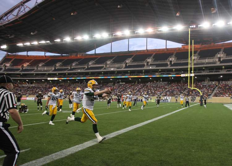 University of Alberta Golden Bears quarterback Ryan Schwartz scores a touchdown during first-half action.