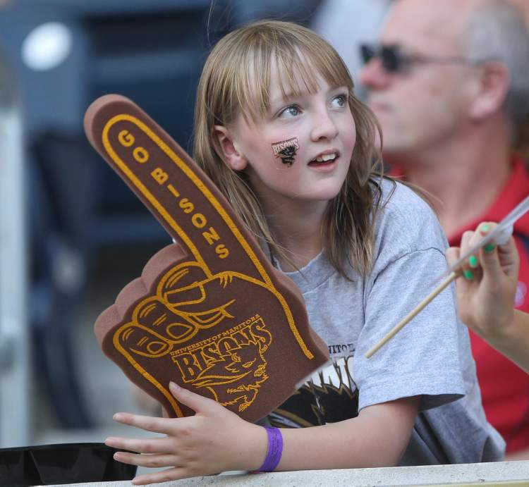 A Bison fan enjoys the Bisons home opener. (JOE BRYKSA / WINNIPEG FREE PRESS)