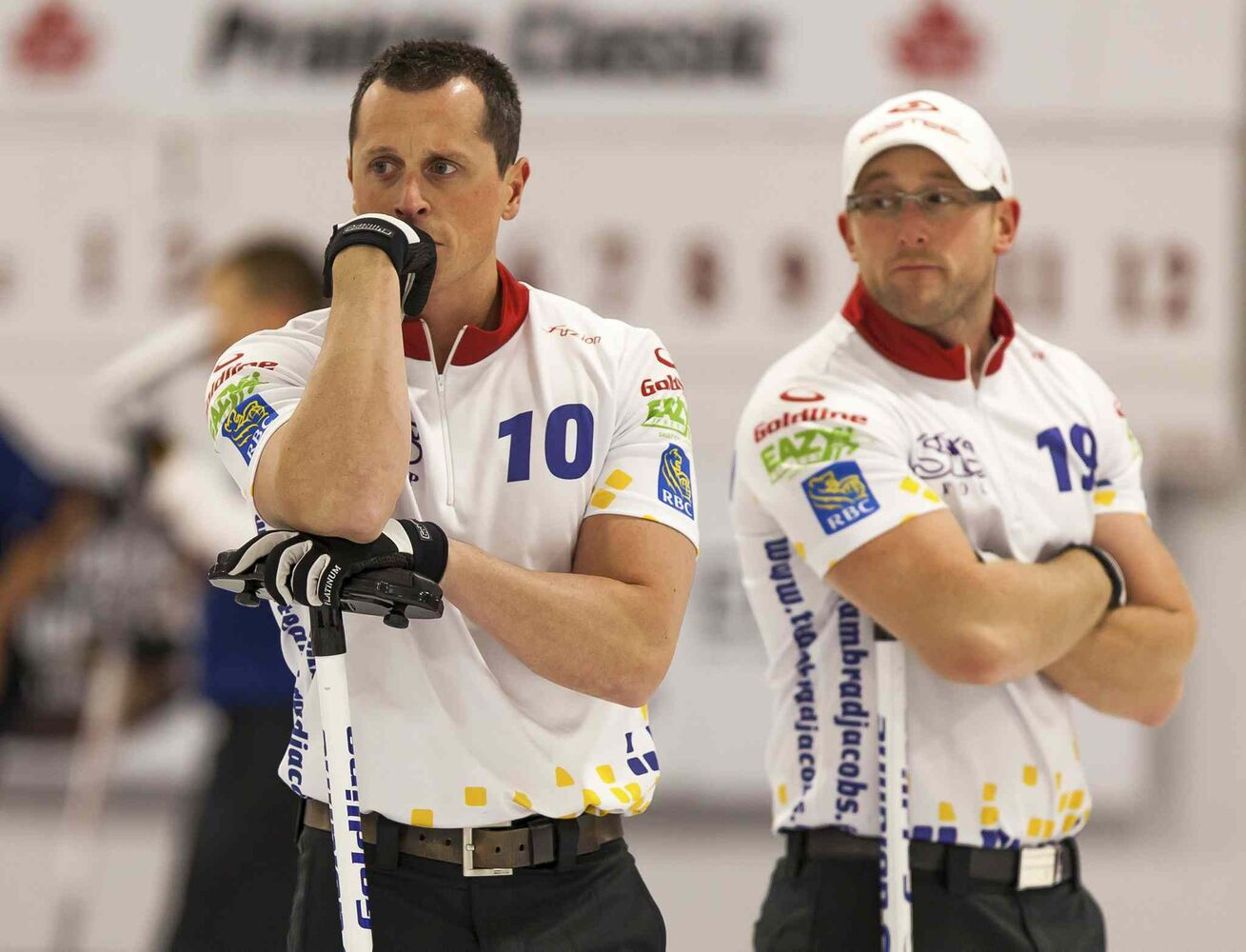 E.J. Harnden (left) and Ryan Harnden of Team Jacobs look on in dismay during their game against Team Kean. They would go on to lose the match 5-4. (Greg Gallinger / Winnipeg Free Press)