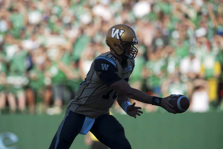 Winnipeg Blue Bombers quarterback Justin Goltz hands the ball off during the second half against the Saskatchewan Roughriders in CFL football action in Regina, Sask., Sunday, September 1, 2013. The Riders defeated the Bombers 48-25. THE CANADIAN PRESS/Liam Richards (Liam Richards / The Canadian Press)