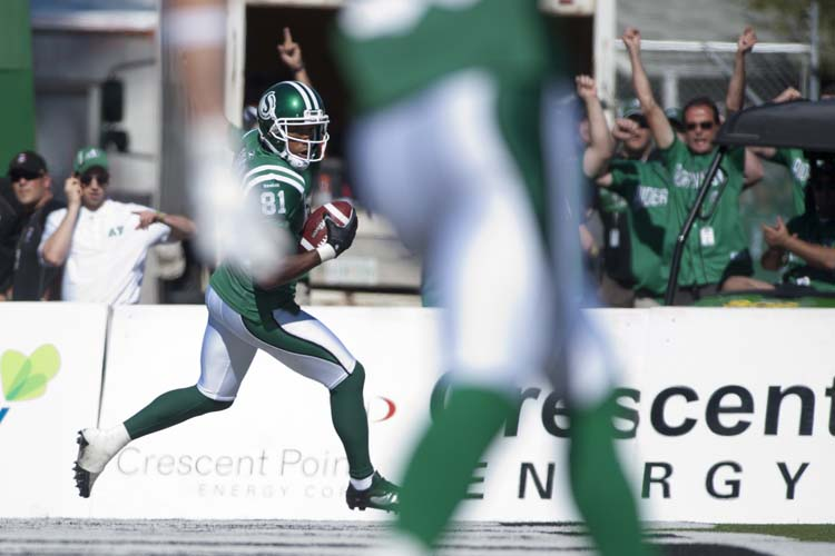 Saskatchewan Roughriders slotback Geroy Simon runs in a touchdown during the first half against the Winnipeg Blue Bombers in CFL football action in Regina, Sask., Sunday, September 1, 2013. THE CANADIAN PRESS/Liam Richards (Liam Richards / The Canadian Press)