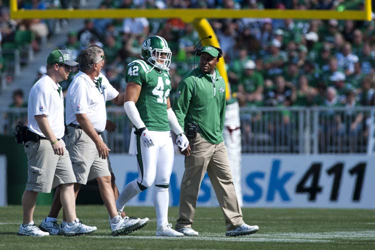 Saskatchewan Roughriders head coach Corey Chamblin, right, checks on defensive back Graig Newman during th first half against the Winnipeg Blue Bombers in CFL football action in Regina, Sask., Sunday, September 1, 2013. THE CANADIAN PRESS/Liam Richards