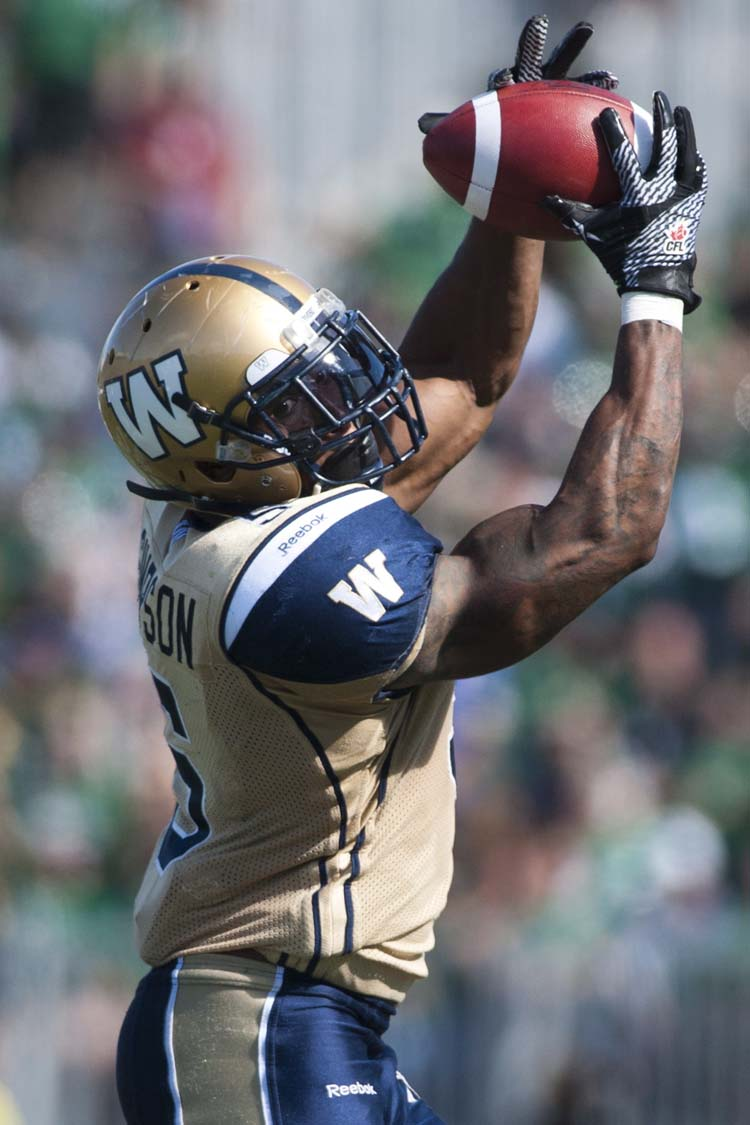 Winnipeg Blue Bombers running back Chad Simpson grabs a pass against the Saskatchewan Roughriders during the first half of CFL football action in Regina, Sask., Sunday, September 1, 2013. THE CANADIAN PRESS/Liam Richards