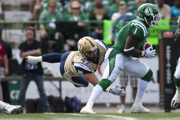 Saskatchewan Roughriders running back Kory Sheets breaks a tackle from Winnipeg Blue Bombers linebacker Pierre-Luc Labbe during the first half of CFL football action in Regina, Sask., Sunday, September 1, 2013. THE CANADIAN PRESS/Liam Richards
