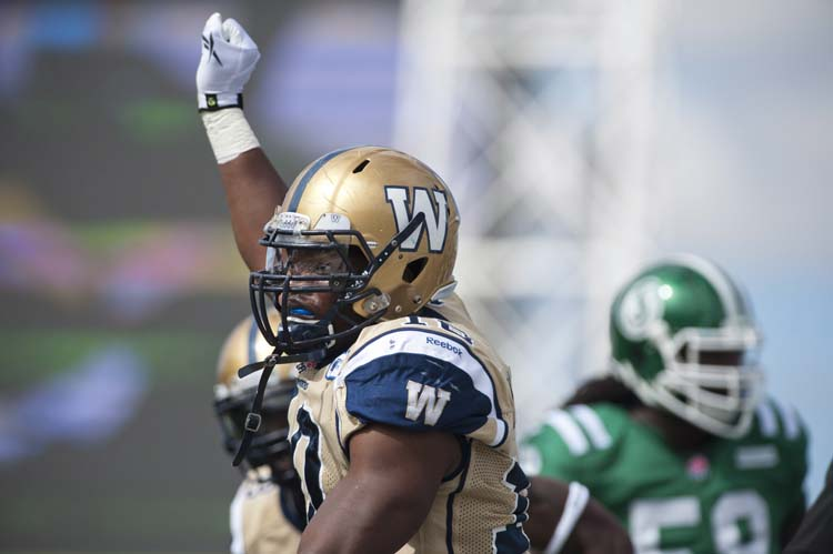 Winnipeg Blue Bombers linebacker Henoc Muamba celebrates a tackle against the Saskatchewan Roughriders during the first half of CFL football action in Regina, Sask., Sunday, September 1, 2013. THE CANADIAN PRESS/Liam Richards (Liam Richards / The Canadian Press)