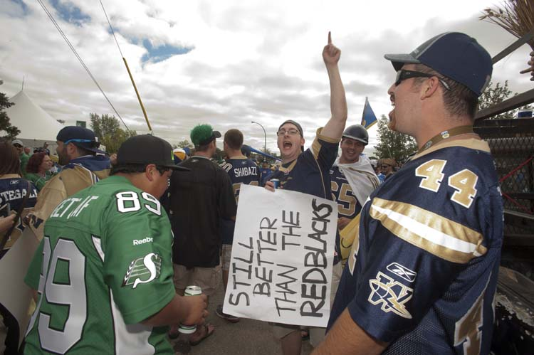 CFL fans show their colours prior to the Labour Day classic game between the Winnipeg Blue Bombers and the Saskatchewan Roughriders in Regina, Sask., Sunday, September 01, 2013.  (Liam Richards / The Canadian Press)