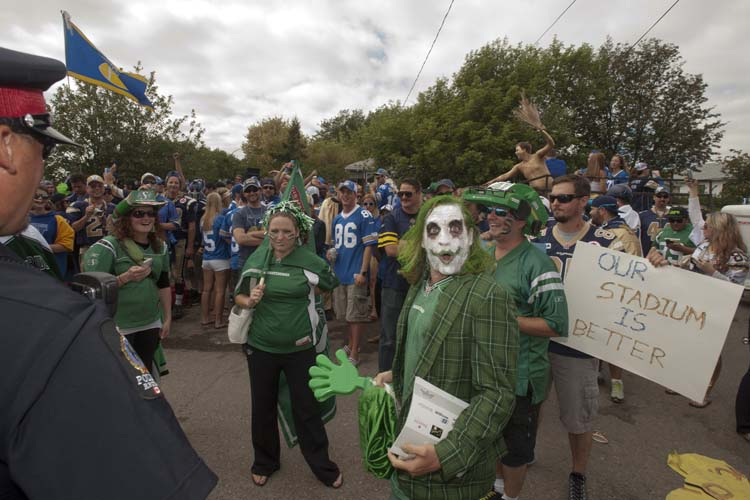 CFL fans show their colours prior to the Labour Day classic game between the Winnipeg Blue Bombers and the Saskatchewan Roughriders in Regina, Sask., Sunday, September 01, 2013. THE CANADIAN PRESS/Liam Richards