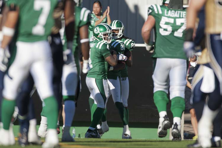 Saskatchewan Roughriders quarterback Darian Durant, left to right, slotback Geroy Simon, and wide receiver Taj Smith celebrate a touchdown against the Winnipeg Blue Bombers during the second half of CFL football action in Regina, Sask., Sunday, September 1, 2013. The Riders defeated the Bombers 48-25. THE CANADIAN PRESS/Liam Richards (Liam Richards / The Canadian Press)