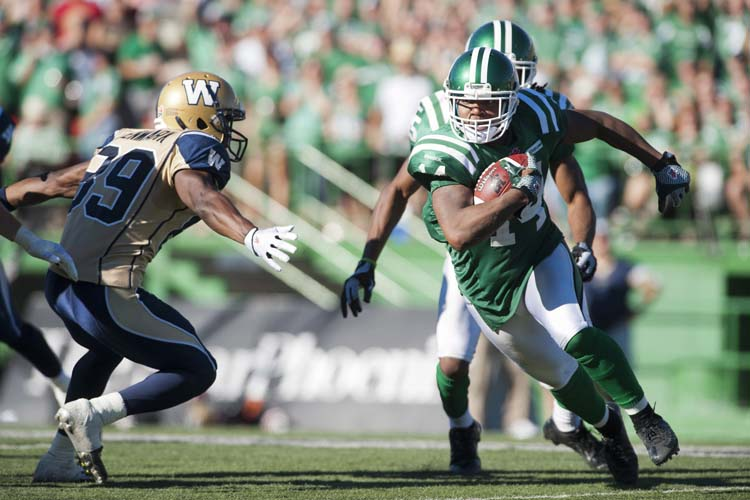 Saskatchewan Roughriders defensive back Prince Miller runs the ball past Winnipeg Blue Bombers slotback Clarence Denmark during the second half of CFL football action in Regina, Sask., Sunday, September 1, 2013. The Riders defeated the Bombers 48-25. THE CANADIAN PRESS/Liam Richards