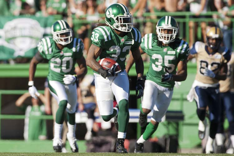 Saskatchewan Roughriders defensive back Dwight Anderson runs the ball after picking off a pass intended for the Winnipeg Blue Bombers during the second half of CFL football action in Regina, Sask., Sunday, September 1, 2013. The Riders defeated the Bombers 48-25. THE CANADIAN PRESS/Liam Richards (Liam Richards / The Canadian Press)