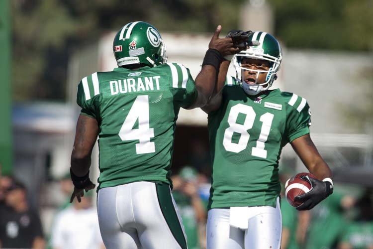 Saskatchewan Roughriders slotback Geroy Simon, right, and quarterback Darian Durant celebrate a touchdown during the first half against the Winnipeg Blue Bombers in CFL football action in Regina, Sask., Sunday, September 1, 2013. THE CANADIAN PRESS/Liam Richards