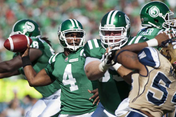 Saskatchewan Roughriders quarterback Darian Durant looks to make a pass during the first half against the Winnipeg Blue Bombers in CFL football action in Regina, Sask., Sunday, September 1, 2013. THE CANADIAN PRESS/Liam Richards (Liam Richards / The Canadian Press)