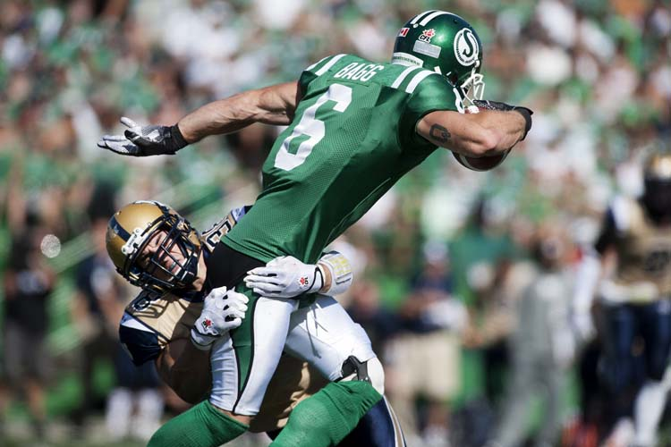 Winnipeg Blue Bombers linebacker Ian Wild tackles Saskatchewan Roughriders wide receiver Rob Bagg during the first half of CFL football action in Regina, Sask., Sunday, September 1, 2013. THE CANADIAN PRESS/Liam Richards