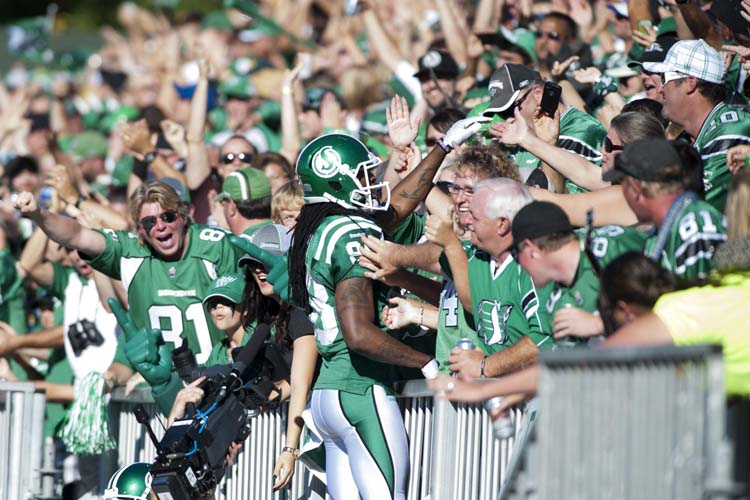 Saskatchewan Roughriders wide receiver Taj Smith celebrates a touchdown with the crowd during the second half against the Winnipeg Blue Bombers in CFL football action in Regina, Sask., Sunday, September 1, 2013. The Riders defeated the Bombers 48-25. THE CANADIAN PRESS/Liam Richards