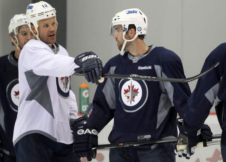 Olli Jokinen , left and team captian Andrew Ladd.